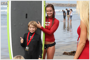 Boys earns a medal after surfing